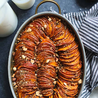 Maple Harissa Sweet Potato Gratin with Almond Dukkah.
