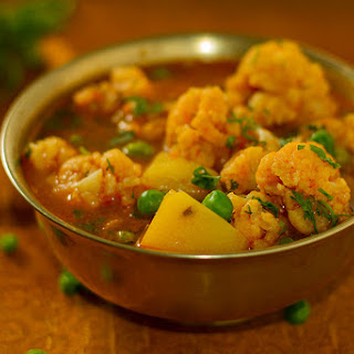 Cauliflower, peas, and potatoes in a thin gravy – Aloo Gobhi Jhol.