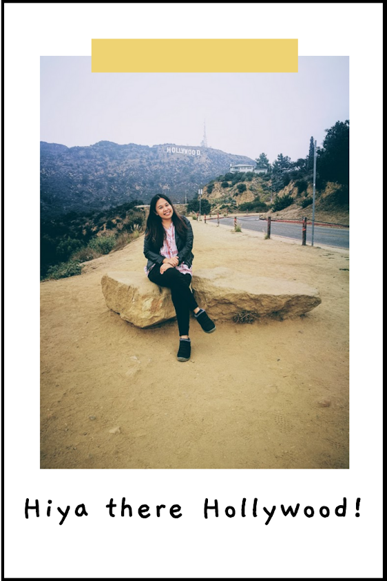 taking a photo with the Hollywood sign in the background
