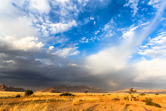 Photo: My previous post was of a lightning strike during a storm that I was lucky enough to witness while in Namibia. I thought some of you might be interested to see what things looked like just one hour earlier. This photo is a wider angle than the lightning photo but was taken from exactly the same location. The sun disappears and the storms roll in fast in this part of the world!