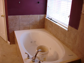 Photo: tiled around as back splash to tub W Jacuzzi.