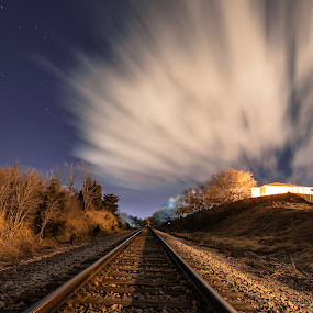 vanishing point by Duane Vosika - Transportation Railway Tracks ( landscapes, omaha, nature, night, train tracks, nebraska, clouds, long exposure, night photography )