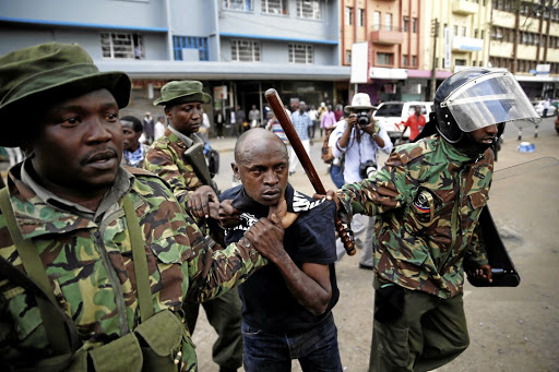 Riot police detain a man during clashes between supporters of Kenya's President Uhuru Kenyatta and supporters of the opposition National Super Alliance (NASA) coalition, during a protest in Nairobi on October 11 2017. Picture: REUTERS
