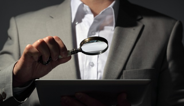 magnifying glass over tablet