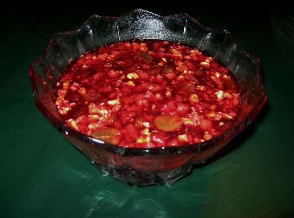 Empty boxes of jello in a large serving bowl and add hot water stir...