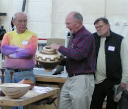 Photo: A slightly out of focus Stan Sherman shows one of his magnificent segmented vessels.