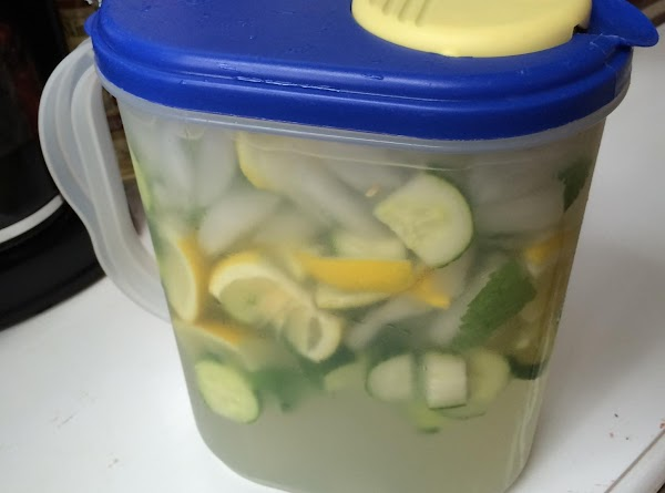 Fill a 1/2 gallon container with ice and water. Add your three ingredients: cucumber,...
