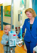 Photo: During her tour of the Department of Pediatric Hematology and Oncology at Hadassah Medical Center-Ein Kerem, Rep. Debbie Wasserman Schultz (D-FL), stopped to exchange a few playful words with four-year-old Ahmad from Bethlehem, who is suffering from leukemia, while exchanging more comforting remarks with his mother, Nurad.