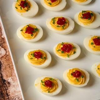 Horseradish Deviled Eggs with Tomato Jam
