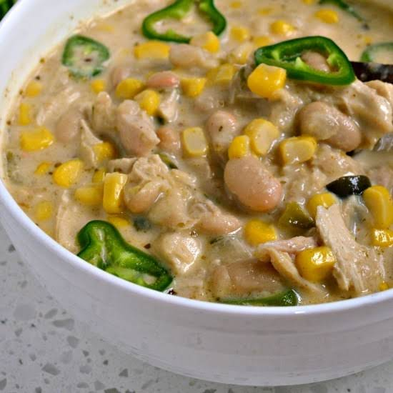 This Easy White Chicken Chili Recipe Is A Creamy Version Of Chili With White Beans, Roasted Chicken, Cream, Poblano Peppers And Anaheim Peppers.  It Is A Welcome Change From The Traditional Red Chili.