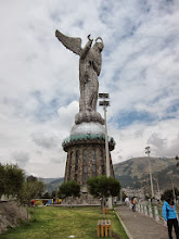 Photo: Winged statue of Mary overlooking the city