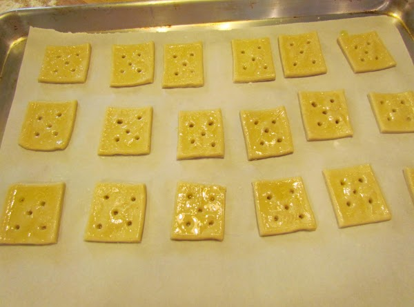 Coat each square using a pastry brush with olive oil. Sprinkle with kosher salt (desired...