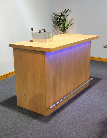 Premium Bar with tap on black carpet with a blue underlight