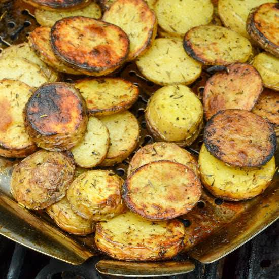 Easy And Tasty Grilled Potatoes With Herbs Are Cooked In A Grill Basket Or Aluminum Foil Right On Top Of Your Charcoal Or Gas Grill.  They Are The Perfect Side For All Your Summer Grilling And Barbecue Recipes.