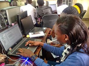 Photo: Girls writing code