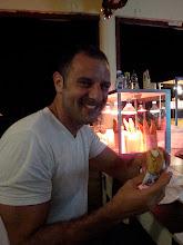 Photo: Stephen, loving his arepa con camarones