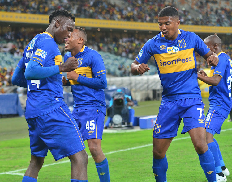 Sibusiso Masina of Cape Town City celebrates a goal with teammates after scoring a goal.