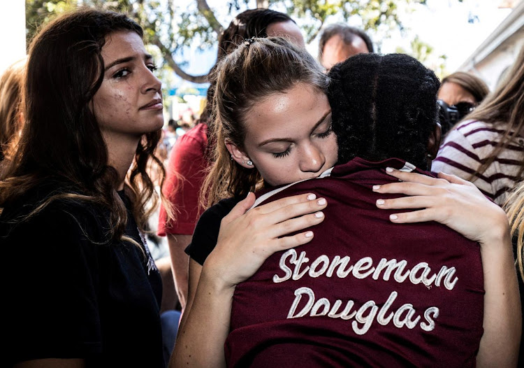 Students from Marjory Stoneman Douglas High School attend a memorial following a school shooting incident in Parkland, Florida. REUTERS/Thom Baur/File Photo