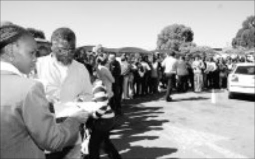 MOTORIST TESTINESS: A staff member gives out testing dates at Langlaagte because the system was slow. People waited in long queues for thier learner's and driver's tests. Pic. Mabuti Kali. 15/05/2007. © Sowetan.