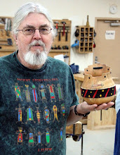 Photo: Ed Karch with one of his uniquely shaped and decorated vessels.