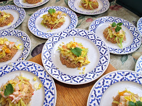 Photo: finished plates of southern-style hot roasted shrimp paste rice with shredded egg, grilled shrimp, sour green mango and tart citrus
