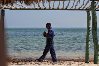 Photo: He was working to clean the beach - meanwhile he brought some cocco to the others