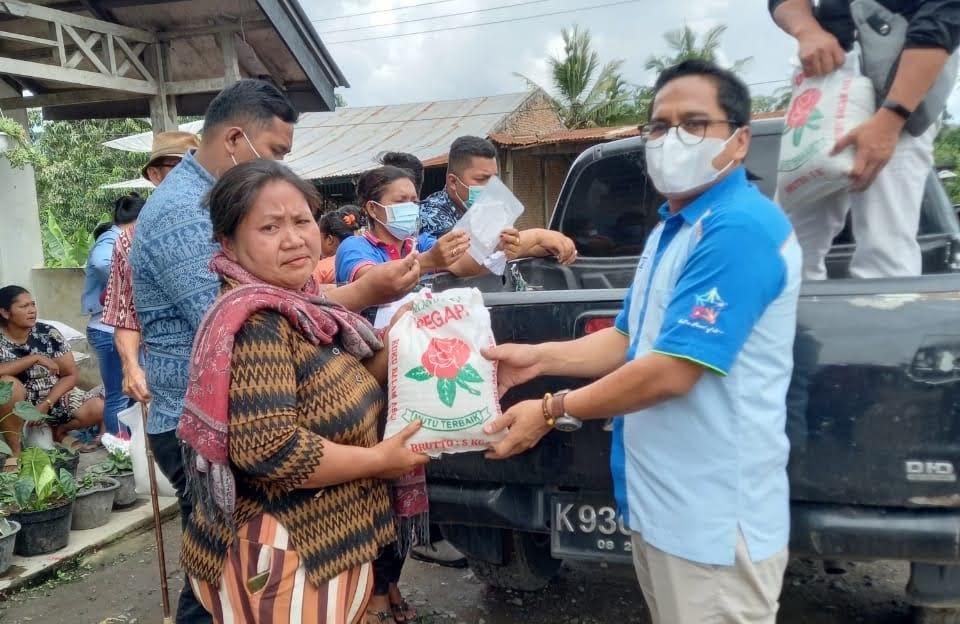 PT BFI Financi Cabang Karo Bakti Sosial Salurkan Bantuan Beras Dan Masker Kepada Warga Desa Bintang Meriah