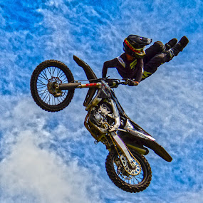 Stunt rider by Andrew Lancaster - Sports & Fitness Motorsports ( motorcycle, sky, motorbike, stuntman, action, riding, brave, sport, skyhigh, dare, jump,  )