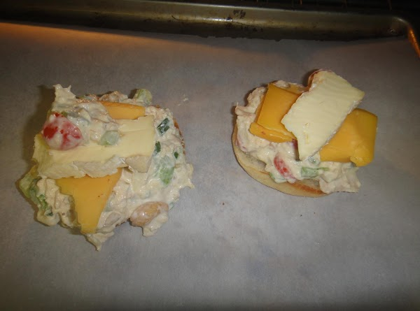 Add tuna mixture and cheese. Place under grill till  cheese is melted. Add the...