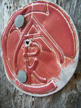 Photo: An old Adirondack Mountain Club trail marker.