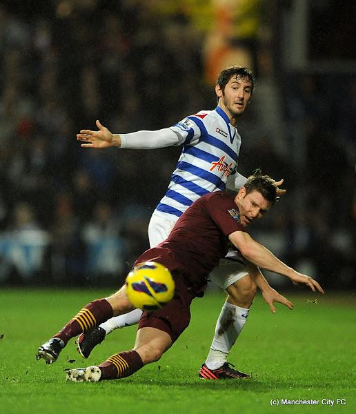 Photo: Queens Park Rangers' Esteban Granero (left) and Manchester City's James Milner battle to the ball