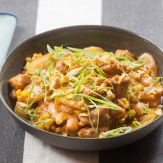 Spicy Chicken & Korean Rice Cakes with Sweet Corn, Shiitake Mushrooms & Ginger Cashews.