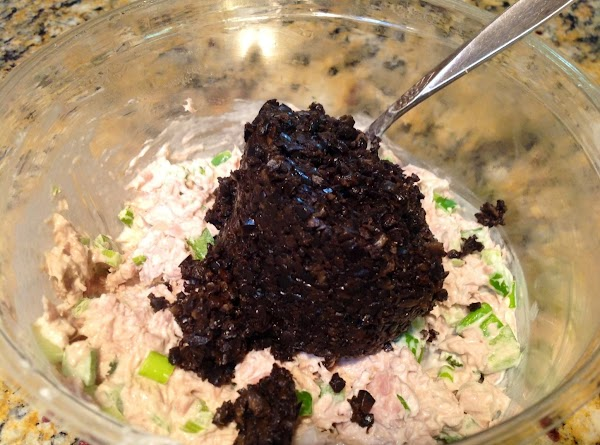 Open can of Chopped Olives and add to Tuna.  Blend well.