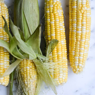 BUTTER BOILED CORN ON THE COB.