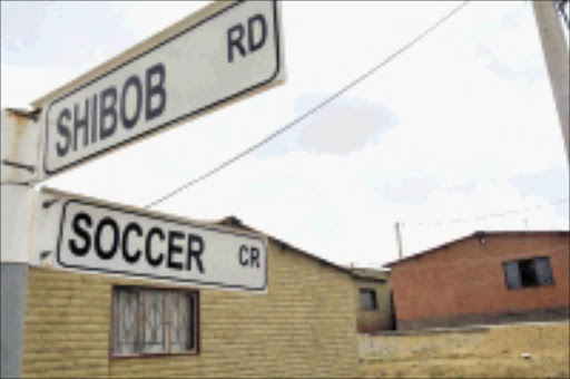 SOCCER PASSION: Streets in Alexandra township Extension 7 depict a soccer catalogue. 19/01/2009. © Sowetan. Pic. Antonio Muchave.