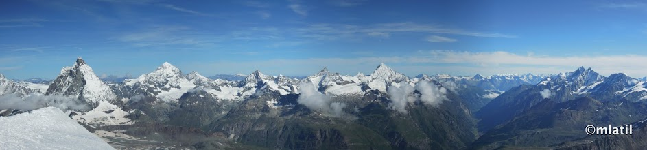Photo: Matterhorn on the left, Zermatt valley and Jungfrau above it on the horizon in the center-right, Rothorn and Taschhorn the two peaks on the right