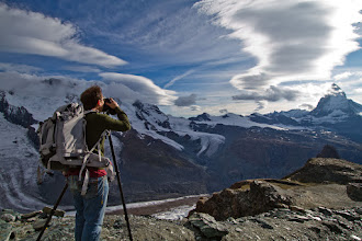 Photo: Leaving France and now exploring the Alps in Switzerland... In this photo below, I'm up in the mountains near Zermatt, taking a photo of the Matterhorn (right side of the photo).  This photo was taken by my friend +Scott Kublin. It's not an HDR image, so you can get a sense of how wild the clouds were on this freezing afternoon. I've been teaching Scott about photography for the past few years, and I think he's made tremendous progress. He used to be absolutely terrible (he would agree with this and smile!), and now he has a new lease on artistic life... great fun!