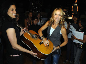 Photo: 10 Oct 2008, Los Angeles, California, USA --- Recording artist Sheryl Crow signs a guitar for auction at the GRAMMY Foundation's GRAMMY SoundChecks program prior to her benefit concert at The Wiltern Theater, in Los Angeles. --- Image by © Katy Winn/Corbis