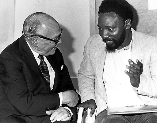 Difficult times: Cyril Ramaphosa, with the late Harry Oppenheimer in this 1986 photograph at the first anniversary celebration of The Weekly Mail newspaper, where they met. Picture: ROBERT BOTHA