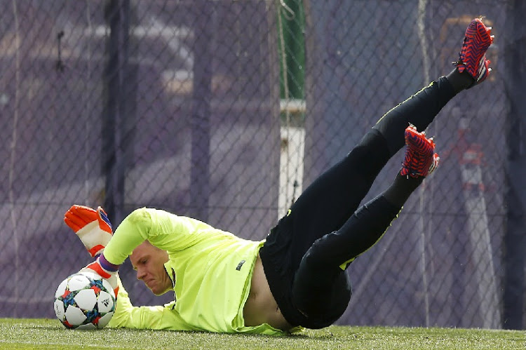 Barcelona goalkeeper Marc-Andre ter Stegen stops a ball during a training session on Tuesday. His team, under Luis Enrique, will play against Bayern Munich tonight, led by coach Pep Guardiola. Picture: REUTERS