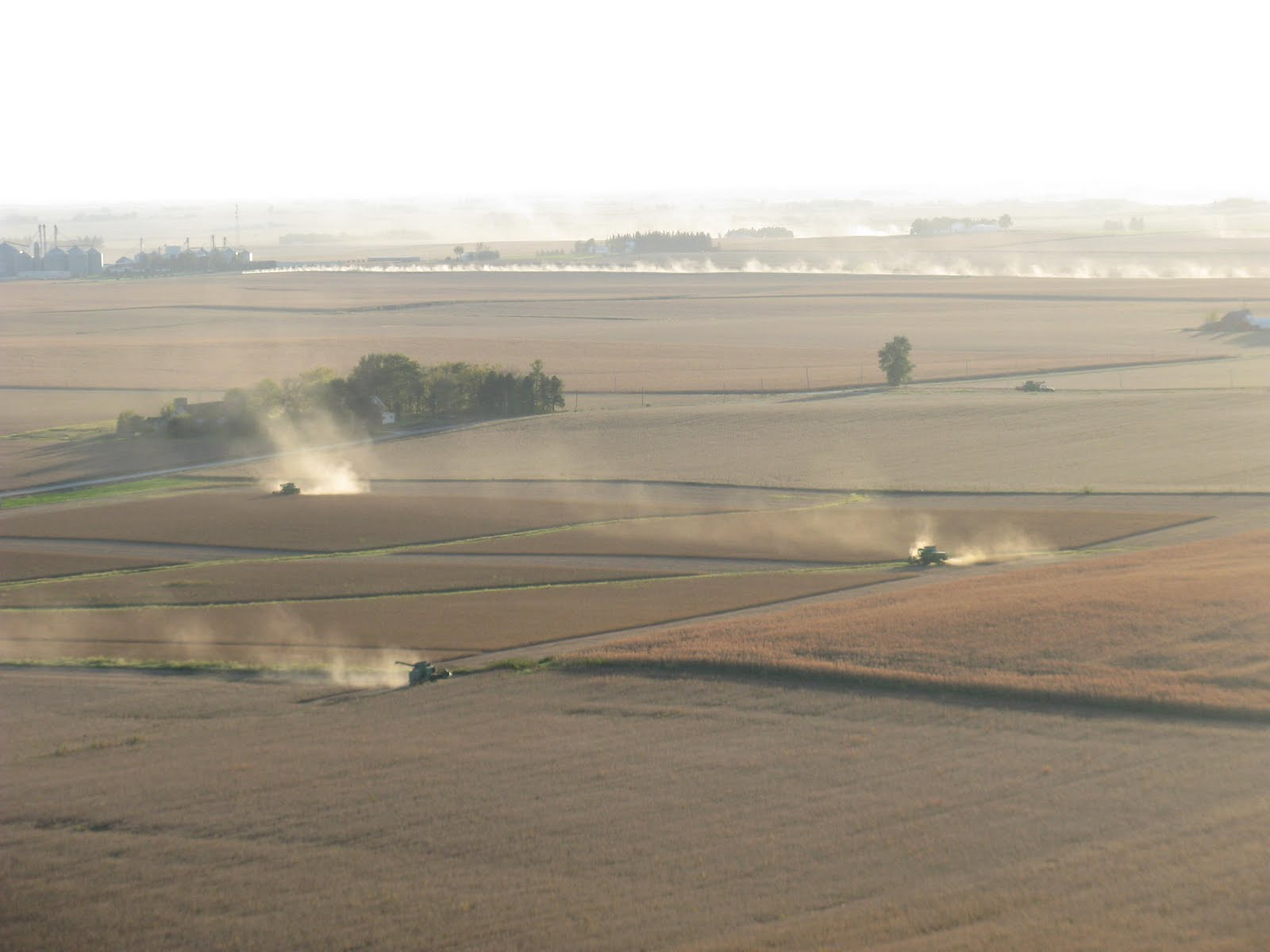 Photo: Dust from 3 soybean combines  AND  one long gravel road
