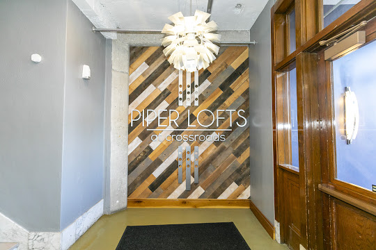 Piper Lofts entry sign with wooden wall and double wooden doors
