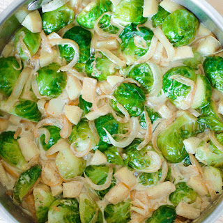 Cheesy Brussels Sprouts with Apples and Onions.