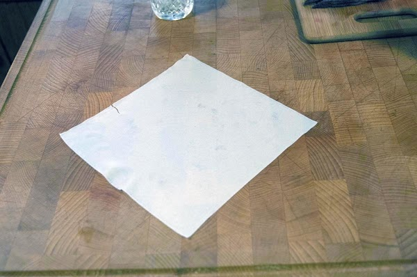 Lay out an eggroll wrapper in a diamond shape.