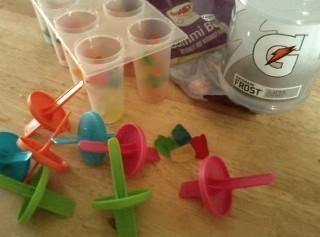 Fill each mold with gummy bears and pour gatorade in each to fill. Place...