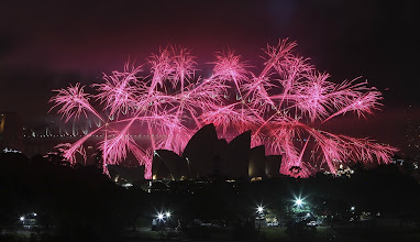 Photo: Fireworks explode behind the Opera House during the New Year celebrations in Sydney, Australia, Tuesday, Jan. 1, 2013.(AP Photo/Rob Griffith) Australia Sydney New Year