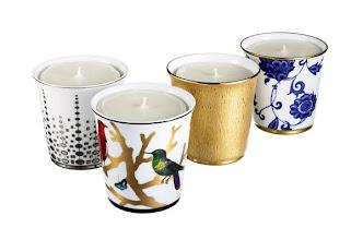 "Photo: BERNARDAUD Porcelain candle tumblers. 3.5″ high. ""Or d'Azur"" with ""Rue des Archives"" fragrance. $125. ""Aux Oiseaux"" with ""Rose"" fragrance. $120. ""Dune"" with ""Pansy"" fragrance. $165. ""Prince Bleu"" with ""Immortal"" fragrance. $130. France. Seventh Floor. 212 872 2686"
