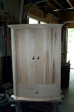 Photo: Curved front wall cabinet.  Maple, spalted maple, and poplar.  21 inches wide, 11 inches deep, and 31 inches high. See an inside view in the next photo.