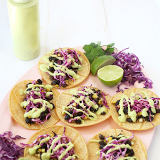 BLACK BEAN & CORN TACOS WITH CABBAGE SLAW AND AVOCADO CREAM