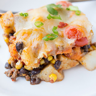 Cheesy, Southwestern Four-Potato & Veggie Casserole with Fire-Roasted Tomato Sauce, Black Beans, Cherry Tomatoes, Caramelized Red Onions and Fresh Cilantro.